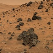 Volcanic rock fragments littering the slope of Low Ridge imaged by the Spirit rover 04-13-06